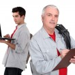 Father and son working together - Stock Photo