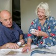 Senior couple with coffee in bed — Stock Photo