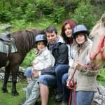 Family stood with horses — Stock Photo