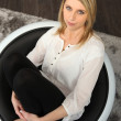 Blonde sitting in bowl in knee-chest position — Stock Photo #9233018