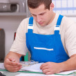 Artisan doing paperwork - Stock Photo