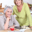 Two women playing an informal game of chess — Stock Photo
