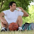 Mwith basketball and bottle of water — Stock Photo #9233226