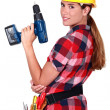 Profile of woman holding drill - Photo