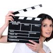 Woman with movie slate - Stockfoto