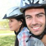 Man and woman riding bikes — Stock Photo #9233837