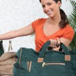 Young woman smiling with travel bag — Stock Photo #9233847