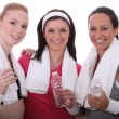 Stock Photo: Three women resting after fitness