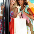 Portrait of two girls with shopping bags — Stock Photo #9234305