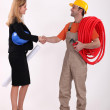 Business professional shaking a tradesman's hand — Stock Photo