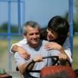 Couple riding tractor — Stock Photo