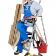 Tradeswoman talking on her mobile phone — Stockfoto