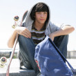 Boy sitting on a step with skateboard — Stock Photo #9234419