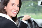 Salesperson driving a car — Stock Photo