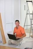 Floorlayer with a laptop computer — Stock Photo