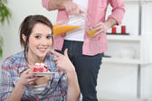 Woman eating a piece of cake — Stock Photo