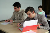 Students hard at work in class — Stock Photo
