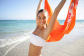 Woman waving kerchief on the beach — Stock Photo