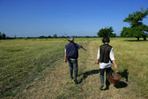 Farming couple in a field — Stock Photo