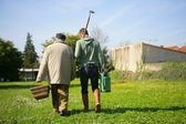 Two men off to do some gardening — Stock Photo