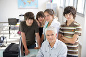 Teacher posing with his pupils — Stock Photo
