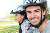 Man and woman riding bikes — Stock Photo