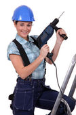 Tradeswoman holding a power tool — Photo