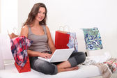Woman surrounded by shopping bags — Stock Photo