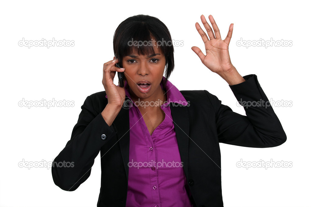 A black businesswoman angry over the phone. — Stock Photo #9231978