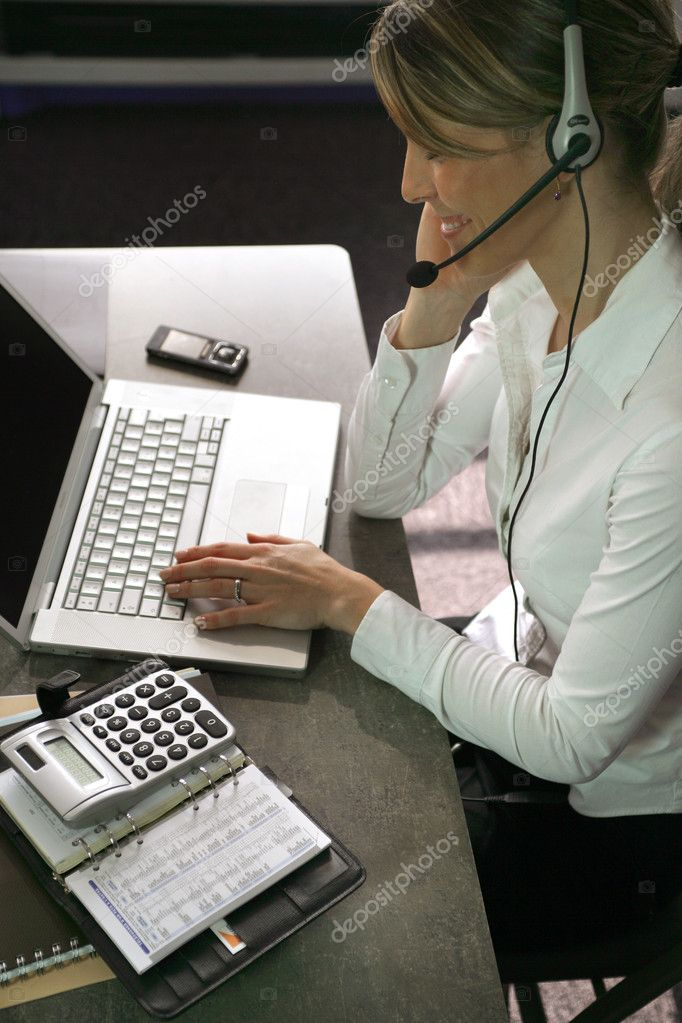 Blond call-center worker sat at her desk — Stock Photo #9232779