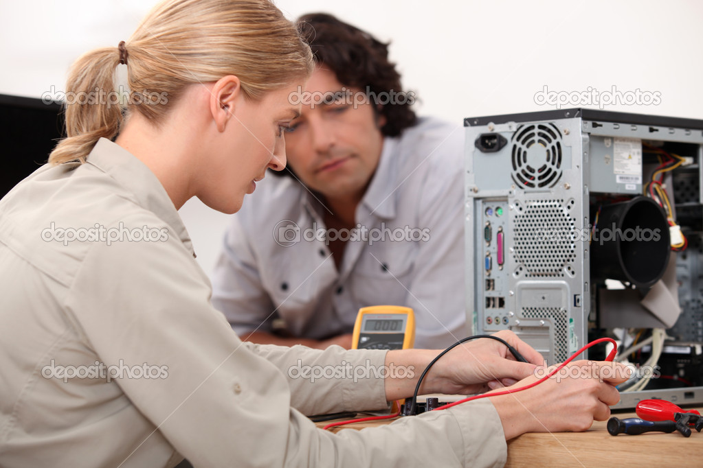 Woman fixing a hard drive  Stock Photo #9233423
