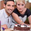 Couple with birthday cake — Stock Photo