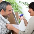 Couple installing furniture — Stock Photo