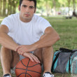 Basketball player sitting — Stock Photo