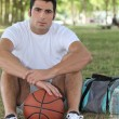 Basketball player sitting - Lizenzfreies Foto