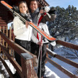 Couple outside ski lodge — Stock Photo #9287121