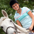 Stock Photo: Young female jockey
