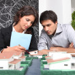 Stock Photo: Architects examining model
