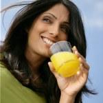 Woman drinking a glass of orange juice — Stock Photo