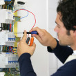 Man repairing faulty fuse box — Stock Photo