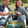Stock Photo: Grapepickers enjoying a glass of wine