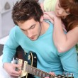 Woman looking guy with guitar — Stock Photo #9287637
