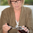 Woman taking syrup — Stock Photo