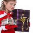 Girl dressed as Santa Claus with gifts — Stock Photo