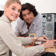 Stock Photo: Womassessing problem with computer