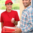 Woman delivering pizza — Stock Photo #9288408