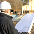 Builder on site with plans — Stock Photo