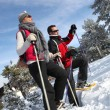 Couple snow-shoeing — Stock Photo #9288536
