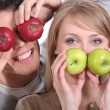 Funny couple covering their eyes with apples — Stock Photo #9288615