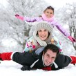Family playing in the snow — Stock Photo